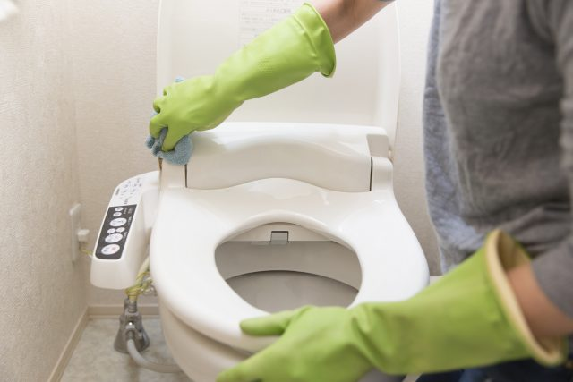 cleaning the toilet