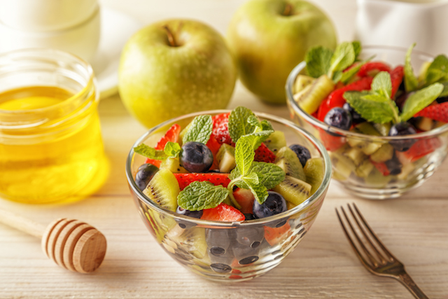 Healthy homemade fruit salad with honey.