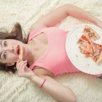 現象・過食症overeat girl lying