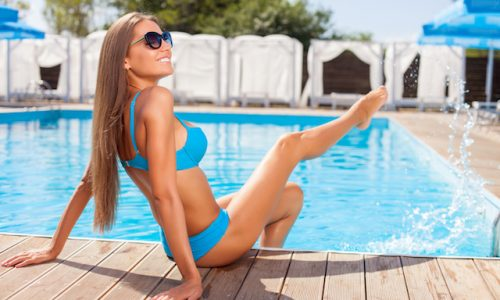 Cheerful young woman is relaxing in summer