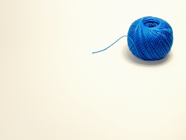 Blue ball of cotton thread for knitting