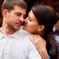 girl sensually hugs her boyfriend