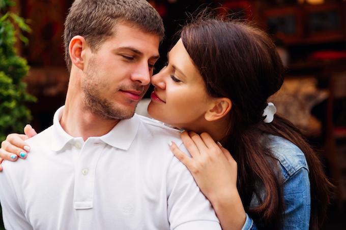 愛・girl sensually hugs her boyfriend