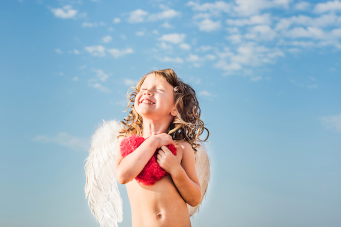little angel holding a heart. St. Valentines cupid girl