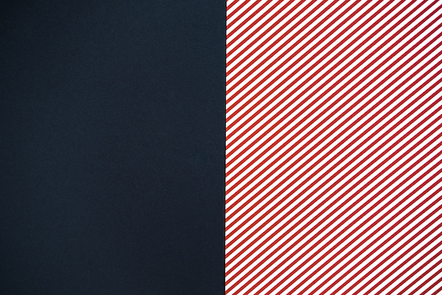 Black, red and white striped background