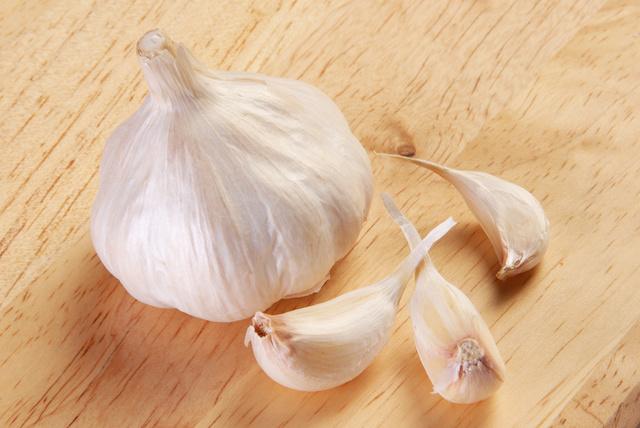 Garlic on wood board closeup