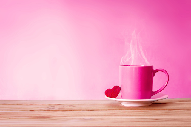 Coffee cup mug with red heart shape on wooden table , Romance and love valentines day background concept