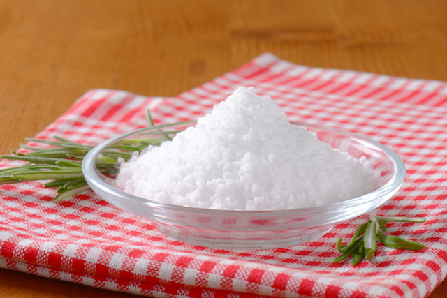 Coarse grained edible salt on small glass plate