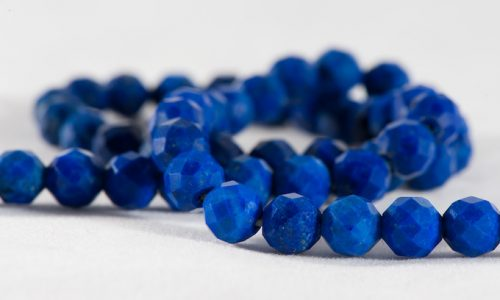 Beads from blue lazurite stone isolated