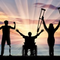 Happy three disabled and sea sunset