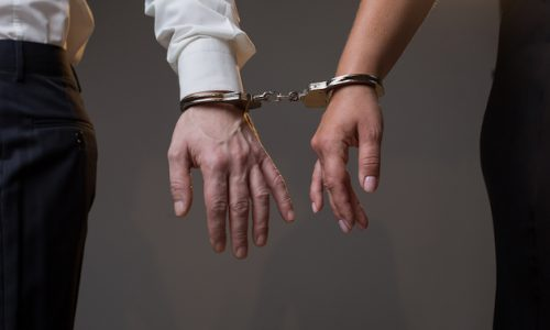Man and woman are tied with manacles