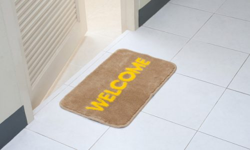 Welcome doormat in front of the rest room