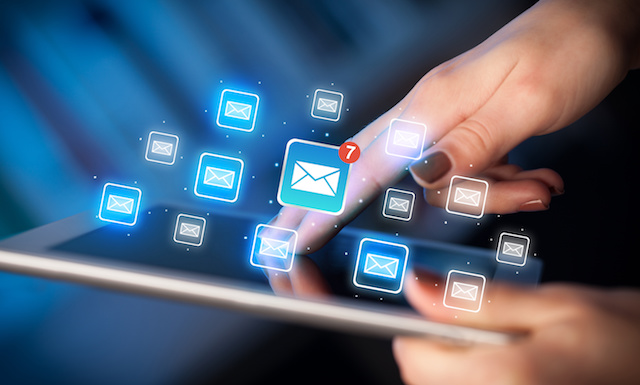 Fingers touching tablet with mail